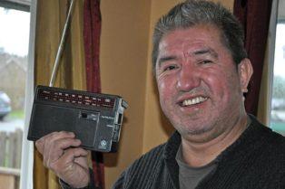 man holding up portable radio