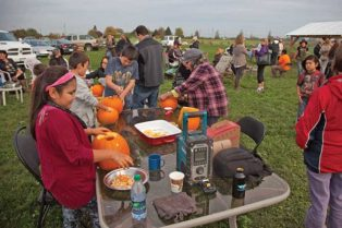 People cleaning pumpkins on a farm