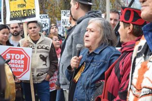 woman speaks to a crowd