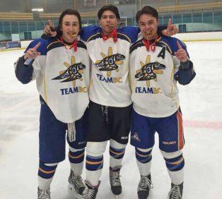 three male hockey players