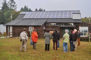 people looking at solar panels on building