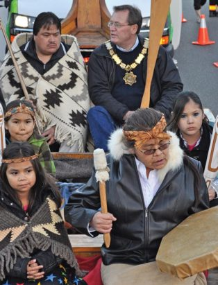 mayor and first nations members in a parade