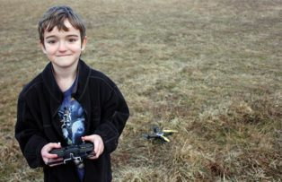 child with drone helicopter