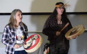 First Nations women drumming and singing