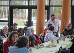 people eating at a community lunch