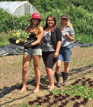 women in a vegetable garden