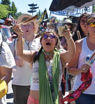 protestors march against Kinder Morgan pipeline