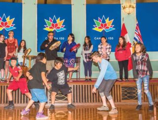 Stz'uminus students sing a song for B.C.'s Lieutenant Governor