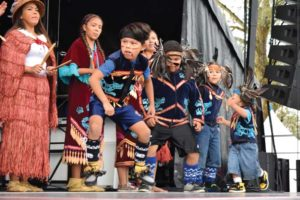 Coast Salish dancers perform