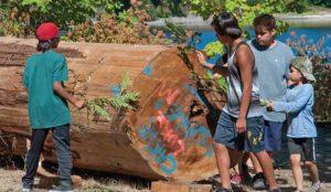 children blessing cedar log