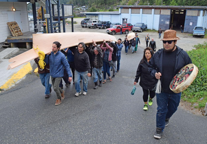 community carrying canoes