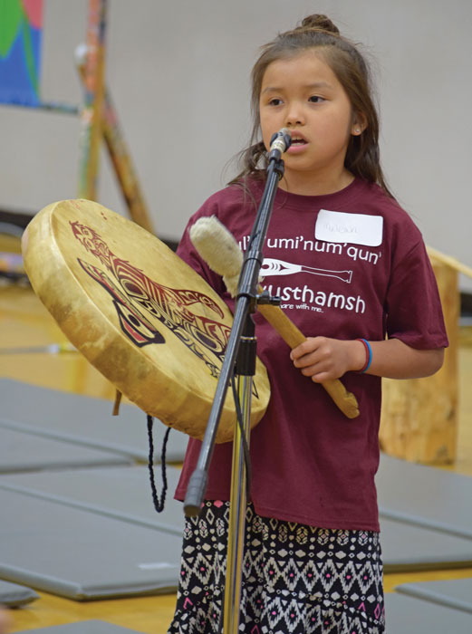 Indigenous student drumming and singing