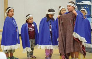 indigenous students make a presentation