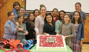 program participants celebrate with a cake
