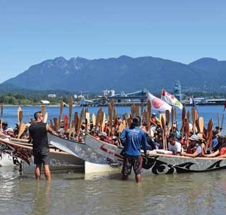 Pulling Together:  Gift of 'Equality Song' unites canoe families