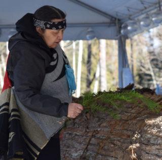 Squamish carvers build canoe at CapU