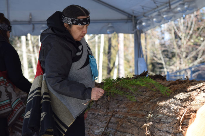 Squamish carvers build canoe at CapU
